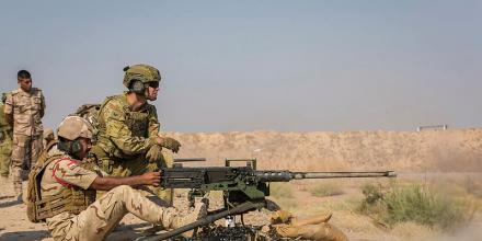 Corporal Luke McFarlane, who is deployed with Task Group Taji 9, observes an Iraqi Army soldier firing a 12.7mm Browning machine gun during a live-fire training exercise at the Besmayah training area, Iraq. Photo: Corporal Nunu Campos