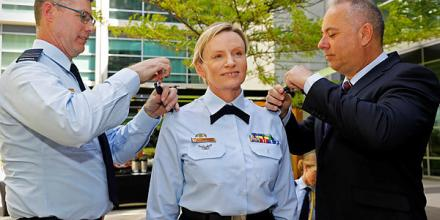 Warrant Officer of the Air Force Fiona Grasby, centre, during the changeover ceremony at Russell Offices, Canberra, with Wing Commander Paul Brnada, left, and Warrant Officer (retd) Troy Javelin. Photo: Corporal Veronica O'Hara