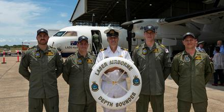 Navy's Laser Airborne Depth Sounder Flight crew, from left, Petty Officer Jarrod McCann, Chief Petty Officer Luke Heard, Lieutenant Commander Mark Matthews, Lieutenant Cheyne Colley and Leading Seaman John Krasicki. Photo: Able Seaman Jarrod Mulvihill