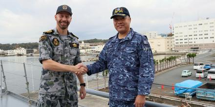 Commander Brett Dawe, left, is welcomed on board Japanese Maritime Self-Defense Force ship, JS Uraga, by Captain Masahiko Koseki as part of Exercise Hyuga Nada. Photo: Lieutenant Commander Kelli Lunt