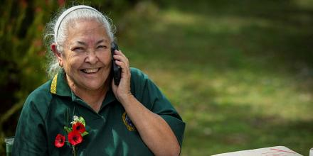 Australian Army veteran Mariann Mathias, of the Women's Royal Australian Army Corps, enjoys a phone call from a current serving Army member as part of the Virtual Veteran Visit initiative. Photo: Trooper Jonathan Goedhart