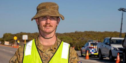 Army reservist Bombardier Christopher Barfield, of 3rd Field Battery, 9th Regiment, Royal Australian Artillery, at a police control point in Western Australia. Photo: Leading Seaman Ronnie Baltoft