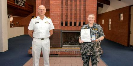 Captain Doug Theobald presents a Fleet Commander silver commendation to Able Seaman Sarah McDonald at an awards ceremony held at HMAS Stirling in Western Australia. Photo: Petty Officer Yuri Ramsey