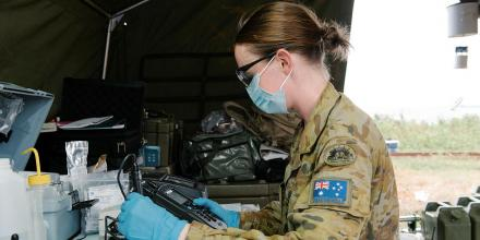 Captain Nicole Eltringham tests water from a desalination system in Vanua Levu on Operation Fiji Assist. Photo: Lieutenant Phillip Qin