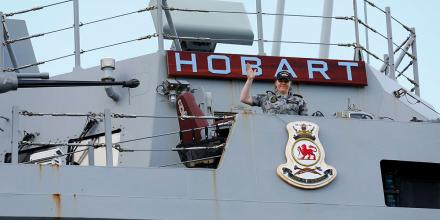 Able Seaman Harriet Shepperd waves from HMAS Hobart while the ship is at anchor on the Derwent River during the Royal Hobart Regatta. Photo: Warrant Officer Class 2 Max Bree