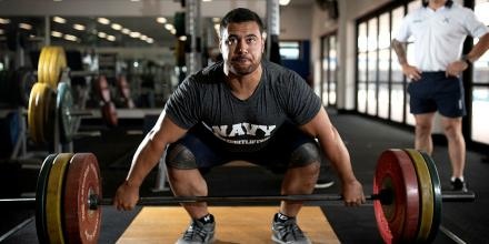 Weightlifter Leading Seaman Suamili Nanai trains at HMAS Stirling in Western Australia under the watchful eye of Leading Seaman Physical Training Instructor Jakob Pekolj. Photo: Petty Officer Yuri Ramsey