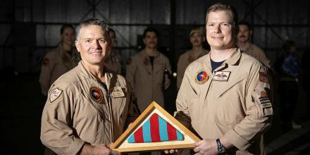The Commander's Pennant for Air Task Group 630 is passed from outgoing commander Wing Commander Ric Peapell, left, to the incoming commander Wing Commander Alexander Cave. Photo: Glen McCarthy