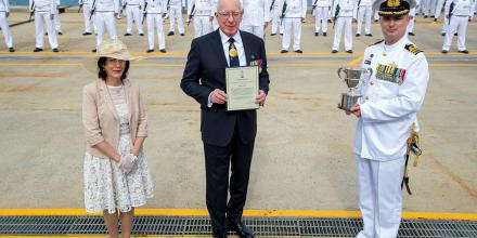 Governor-General General (retd) David Hurley, centre, and his wife Linda Hurley present the 2020 Duke of Gloucester Cup to Commanding Officer HMAS Arunta Commander Anthony Nagle. Photo: Leading Seaman Richard Cordell
