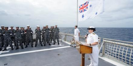 Lieutenant Commander Sara Barnett speaks to HMAS Melville's ship's company during a service held off the coast of Papua New Guinea to commemorate the Australian submarine AE1. Photo: Able Seaman Leon Dafonte Fernandez