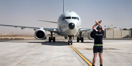 A Royal Australian Air Force airman marshals in the P-8A Poseidon on its arrival at the ADF's main operating base in the Middle East region. Photo: LSIS Craig Walton