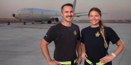 Royal Australian Air Force airman Corporal Josh Golding and Leading Aircraftwoman Tiane Hoffmann in front of a P-8A Poseidon aircraft at Australia's main operating base in the Middle East region. Photo: Leading Seaman Craig Walton