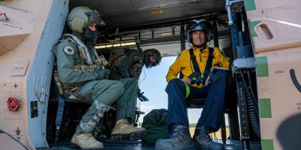 Leading Seaman Aircrewman Benjamin Nixon, left, Petty Officer Aircrewman Damien Wallace, centre, and Rural Fire Service volunteer Jeff Hodder prepare to leave Royal Australian Air Force Base Williamtown, Newcastle. Photo: Able Seaman Leo Baumgartner