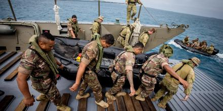 Soldiers from the Australian Army and His Majesty's Armed Forces of Tonga prepare to board a Zodiac from an Australian Army landing craft during an amphibious training exercise in Nukuʻalofa. Photo: Corporal Jessica de Rouw