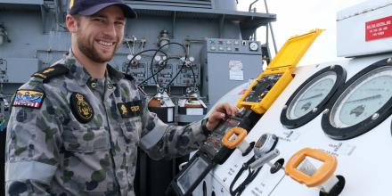 Able Seaman James Steer checks the communications system on the diver compression chamber in minehunter HMAS Diamantina. Photo: Commander Kelli Lunt