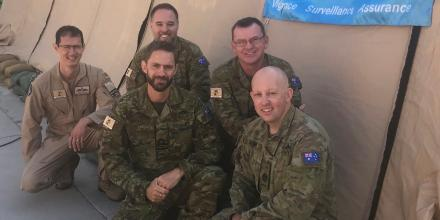 From left, Squadron Leader Carl Godwin, Lieutenant Commander Daniel MCall, Lieutenant Commander Glenn Suffolk, Lieutenant Commander Darren Cooper and Warrant Officer Dean McLeod at the IMSC headquarters in the Middle East. Photo: Commander Michael Miller