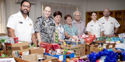 Lily Tan, Wendy Wolanski and St Vincent De Paul regional president Edward Wolanski, flanked by members of Submarine Force, with the Christmas gifts. Photo: Leading Seaman Richard Cordell