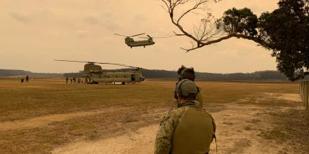 No. 4 Squadron Combat Control Team members helping with the evacuation of civilians from Mallacoota airfield.