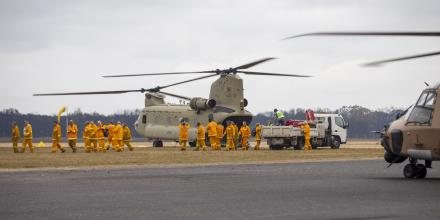 Victorian CFA firefighters arrive on an Australian Army CH-47 Chinook helicopter at Mallacoota. Photo: Corporal Nicole Dorrett
