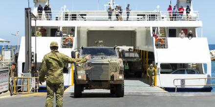 Bushmasters are loaded onto the Kangaroo Island ferry at Cape Jervis in South Australia as part of Operation Bushfire Assist. Photo: Corporal Tristan Kennedy