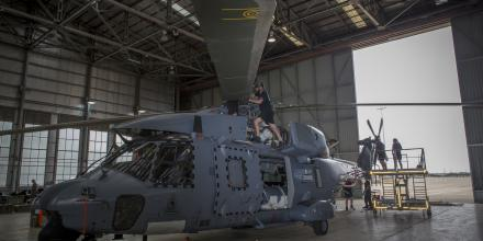 Royal New Zealand Air Force Corporal Damo Herlihy prepares the main rotors on an  NH90 at RAAF Base Richmond in preparation to help with the bushfire efforts. Photo: Sergeant Christopher Dickson