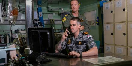 HMAS Adelaide's embarked nursing officers, Lieutenant Commander Thomas Miller (front) and Lieutenant Travis Robinson, in the treatment room. Photo: Able Seaman Thomas Sawtell