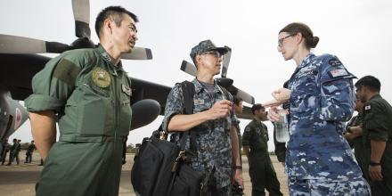 Flight Lieutenant Rebecca Marshall speaks with Japan Self-Defense Force personnel after their arrival at RAAF Base Richmond. Photo: Corporal David Said