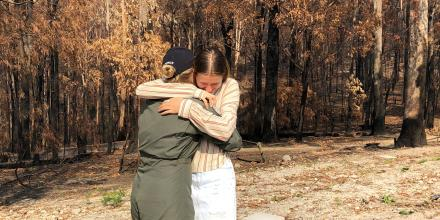 Pilot Officer Isabella Filmer is reunited with her sister, Ashlee, at their home in Mallacoota.