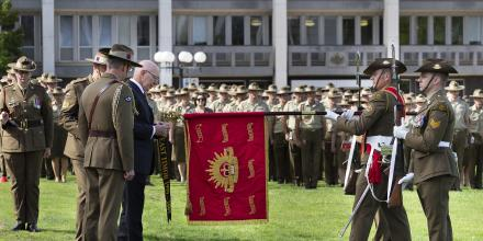 Governor-General General (retd) David Hurley attaches a streamer bearing the Theatre Honour East Timor 1999-2003 to the Army Banner. Photo: Sergeant Hamish Paterson