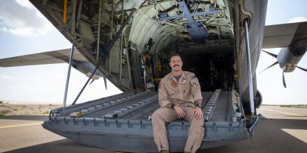 Corporal Callen Burmester on the rear cargo ramp of a C-130J Hercules at an airfield in the Middle East. Photo: Petty Officer Yuri Ramsey