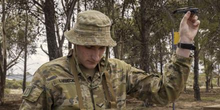 Lance Corporal Ash-Leigh Liebeck, of the 7th Battalion, Royal Australian Regiment, prepares to launch the Black Hornet nano unmanned aerial system. Photo: Private Luke Jones
