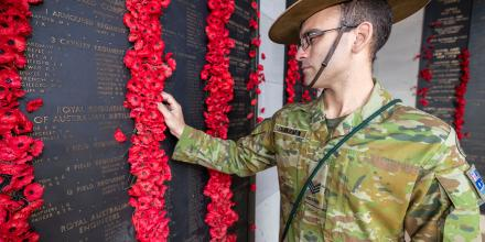 Sergeant James Duquemin looks at the Roll of Honor at the Australian War Memorial in the days leading up to Anzac Day. Photo: Corporal Sebastian Beurich