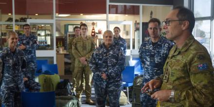 Colonel David Hughes addresses Australian Defence Force personnel and members of the Australian Medical Assistance Team at Burnie Airport before they leave Tasmania. Photo: Sergeant Mark Doran