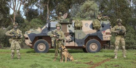 Military working dog handler Leading Aircraftwoman Janice Bastow with her fellow security team members at RAAF Base Edinburgh. Photo: Corporal Brenton Kwaterski