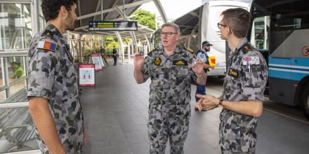 Commander Shore Force Captain Stephen Bowater speaks with Able Seamen Lincoln Matahau, left, and Daniel Sawaqed at Sydney International Airport.  Photo:  Petty Officer Justin Brown