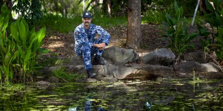 Personnel Capability Officer Flying Officer Coomara Munro, from Air Mobility Training and Development Unit, sits at the duck pond behind the Officers' Mess at RAAF Base Richmond. Photo: Sergeant Christopher Dickson