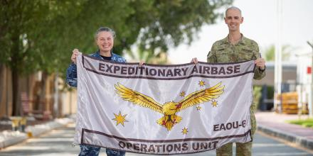 Leading Aircraftman Matthew Shomali is presented with the Expeditionary Airbase Operations flag by Commanding Officer Wing Commander Shannah Forrest. Photo: Petty Officer Yuri Ramsay