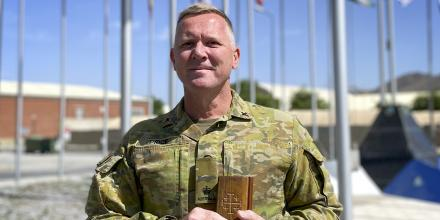 Chaplain Peter Price with his wood-covered bible in Kabul, Afghanistan.
