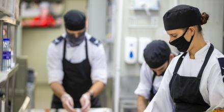 Air Force chefs prepare meals in the kitchen at Australia's main operating base in the Middle East. Photo: Petty Officer Yuri Ramsey