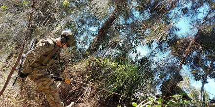A soldier from the 2nd Combat Engineer Regiment abseils to a casualty in a confined space during personnel rescue training in Brisbane.