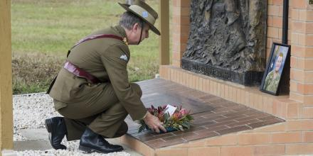 The Commander of the 7th Combat Brigade, Brigadier Jason Blain lays a wreath during a memorial service for Private Nathan Bewes at Gallipoli Barracks, Brisbane. Photo: Corporal Nicole Dorrett
