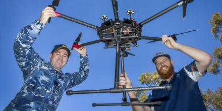 Corporal Lee O'Regan and Electronics Apprentice Nicholas Callaghan with the DJI Matrice UAV at the Instrumentation Maintenance and Electronic Fabrication section at DST Edinburgh, South Australia. Photo: Sergeant Bill Solomou