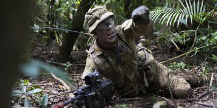 Lieutenant Patrick Omodei, of 3rd Battalion, Royal Australian Regiment, calls out enemy target indications during the Infantry Regimental Officers Basic Course. Photo: Corporal Brodie Cross