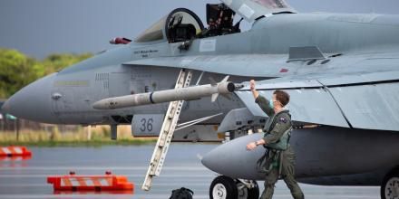 A Royal Australian Air Force pilot from No. 77 Squadron conducts a pre-flight inspection on an F/A-18A Hornet A21-36 aircraft before an air-sea integration mission, at Andersen Air Force Base, Guam. Photo: Sergeant Guy Young
