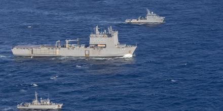 HMAS Choules, centre, and HMAS Huon, bottom, rendezvous with French Naval Ship d'Entrecasteaux during the Australian ships' transit to Vanuatu. Photo: Leading Seaman James McDougall