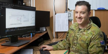 Draughtsman Lance Corporal Glynn Stewart creates plans for a proposed car park shelter at the ADF's main operating base in the Middle East region. Photo: Corporal Tristan Kennedy