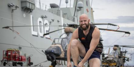 Leading Seaman Scott Tunnard prepares to run on the flight deck of HMAS Canberra during Regional Presence Deployment 2020. Photo: Petty Officer Tom Gibson