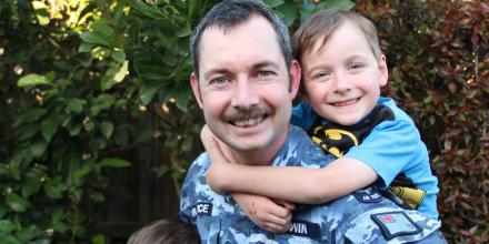 Aircraft technician Corporal Jeremy Lewin, from No. 36 Squadron, at his Ispwich home with sons Joshua, 8, and Ethan, 5. Photo: Danielle Lewin