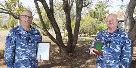 Warrant Officers Stuart Thomas, left, and Perry Thomas with their Fifth Clasp to the Defence Force Service Medal, Federation Star and certificate of recognition for 40 years' service. Photo: Corporal Jesse Kane