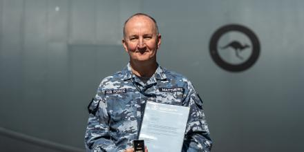 Warrant Officer Stuart Matthews receives his Federation Star and the fifth clasp to his Defence Long Service Medal at RAAF Base Richmond, NSW. Photo: Gordon McComskie
