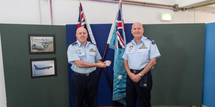 Commander Air Warfare Centre Air Commodore Brendan Rogers, left, presents Squadron Leader Peter Knox with his medallion at RAAF Base Edinburgh. Photo: Leading Aircraftwoman Jacqueline Forrester
